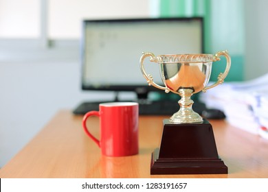 Close-up of the trophy on the office desk Computer as background