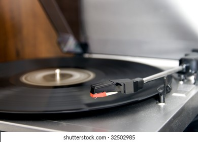 Closeup of a turntable playing a vinyl record