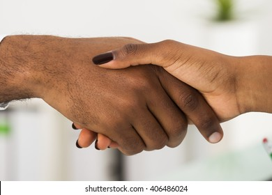 Close-up Of Two African People Shaking Hands