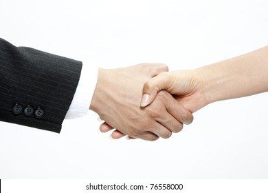 Closeup of two business men shaking hands on a deal