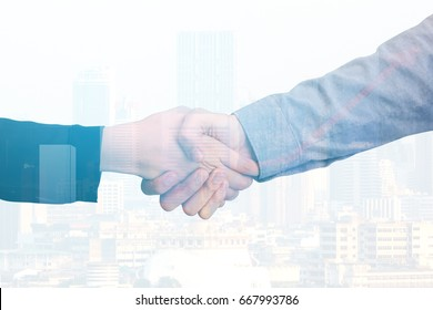 Closeup of Two Business Shaking Hands