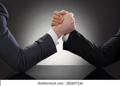 Close-up Of A Two Businessman Competing In Arm Wrestling