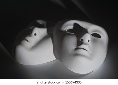 Close-up of two face masks