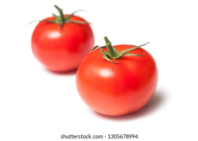 closeup of two fresh tomatoes on white background