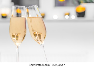 Closeup of two glasses filled with champagne