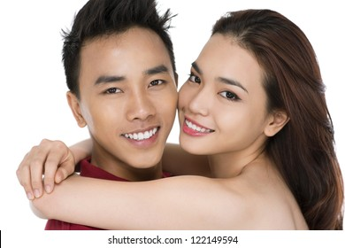 Close-up of two happy people embracing