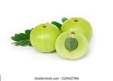 Closeup two Indian gooseberry fruits or Amla berry ( phyllanthus emblica ) with green leaf and sliced isolated on white background.