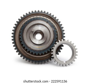 Closeup of two metal cog gears isolated on white.