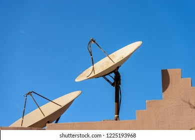Close-up of two old and rusty satellite dishes on the roof of an Egyptian house, Africa