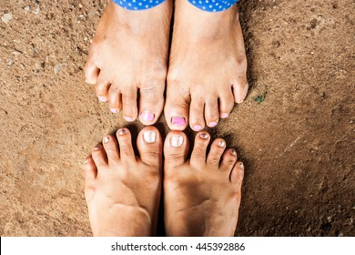Close-up Two old woman's foots short standing on cement background together.