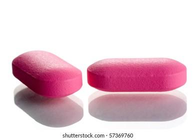 closeup of two pink pills