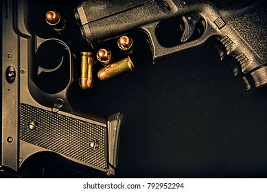 Closeup of two pistols handguns trigger for shooting self defense or military