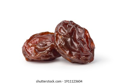 Close-up two Raisins isolated on white background. Clipping path.