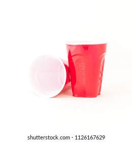 Close-up two red party cups isolated on white background. Studio shot disposable picnic cups recycle mug with clipping path and copy space