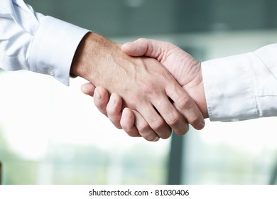 Close-up of two shaking male hands
