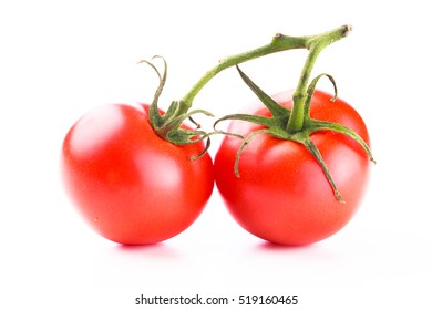 Closeup of two shiny red round tomatoes with a green vine stem on a white background