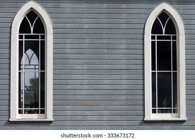 Closeup of Two Windows on the side of a  Country Church