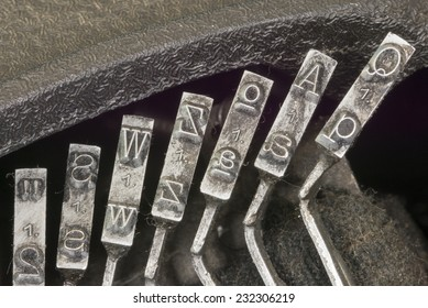Closeup to typebars of an antique mechanical desktop typewriter