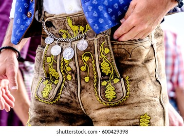 "close-up of a typical bavarian ""krachlederne"" - traditional clothing with antique coins"