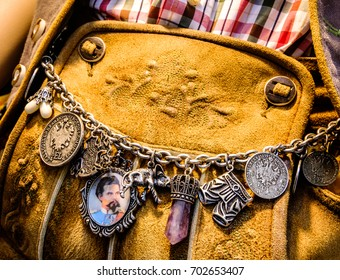 """close-up of a typical bavarian """"krachlederne"""" - traditional clothing with antique coins"""