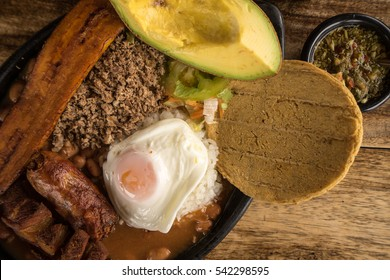closeup of typical colombian food from the Medellin area called Paisa Bandeja