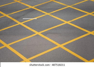Closeup of typical yellow street markings in downtown Hong Kong, China