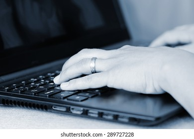 Close-up of typing female hands on keyboard.  Business woman hand typing on laptop keyboard.