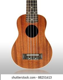 Closeup of ukulele isolated on white background.