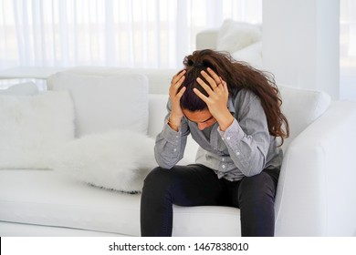 Close-up of unhappy crying woman covering her face useful to illustrate stress, depression or domestic violence. Woman depression or domestic violence