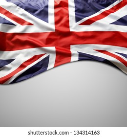 Closeup of Union Jack flag on plain background. Copy space