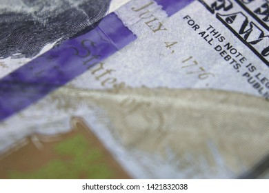 "Close-up Of United States One Hundred Dollar Bill With Extreme Narrow Focal Range Highlighting ""July 4, 1776"""