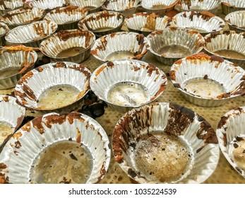 Closeup used aluminium bakery cup made of cupcake.