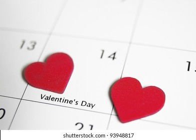 closeup of a valentine calendar with red hearts