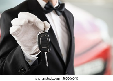 Close-up Of A Valet Boy Holding A Car Key Outside The Car