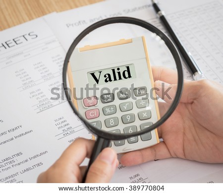 Closeup Valid Text On Calculator Magnifying Stock Photo Edit Now