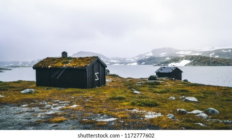 Close-up of a valley Landscape and traditional norwegian houses grass roofs farm village in Norway Travel scenery scandinavian wooden architecture