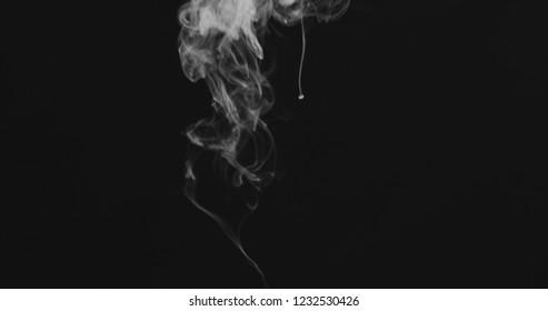 closeup vapor stream rises from bottom center on black background