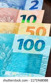 Closeup of varied values of Brazilian money. Economy of Brazil concept image.