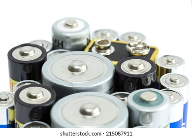 Closeup of variety of batteries, isolated on white background