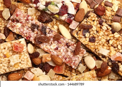 Close-up of various cereal bars with dry fruits and nuts