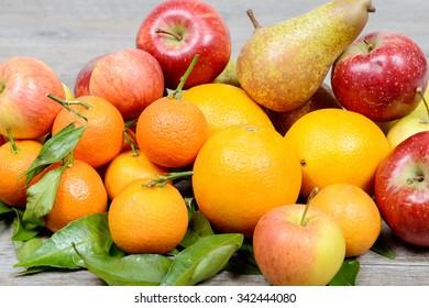 Close-up of various fruits, orange, apple, pear, mandarins