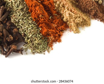 closeup of various spices over white