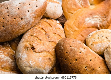 close-up various types of fresh homemade bread, background