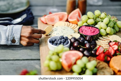 Closeup of a vegan cheese and fruit platter