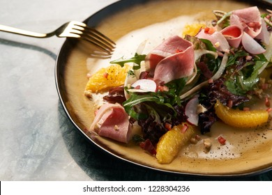 Close-up vegetable salad with Smoked duck breast.  Healthy fresh vegetable salad with smoked chiken meat, Candied Walnuts, Spring Greens, Orange and Herbs