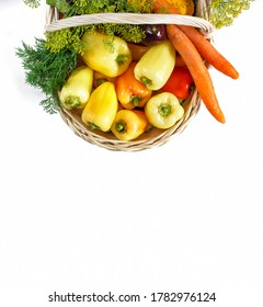 Close-Up Of Vegetables In white Basket Over White Background. Top view
