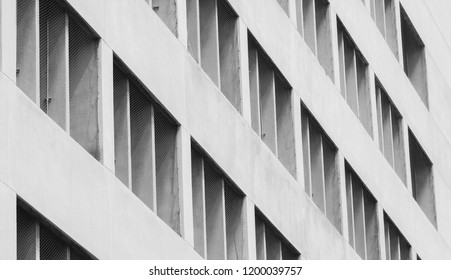 Closeup ventilated facade of concrete building. White ventilation with creative and beautiful pattern architecture. White building. Architecture abstract background.