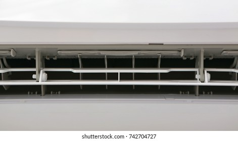 Close-up ventilation grille of air conditioner on wall