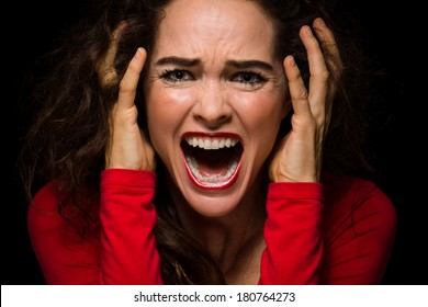 Close-up of a very angry, upset and desperate woman, screaming.