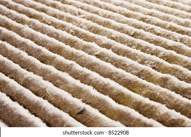 A close-up of a very dirty air filter